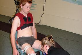 Keegan McCluskey, with gait physiotherapist Julie Edwards, being fitted with reflective markers for 3-D gait analysis.