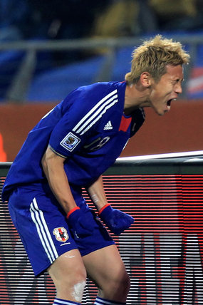 Japan's Keisuke Honda celebrates after scoring with a free kick.