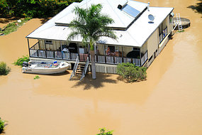 Cut off: Floodwaters surround a home in Rockhampton.