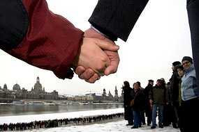 Thousands of people create a human chain along the Elbe River in Dresden