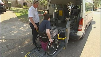 Accessible taxi with passenger about to board