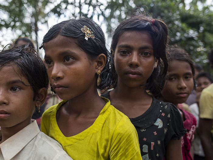 Image: Cox's Bazar district, children waiting in line for relief from the Bangladesh Red Crescent Society. (Source: ABC licensed)