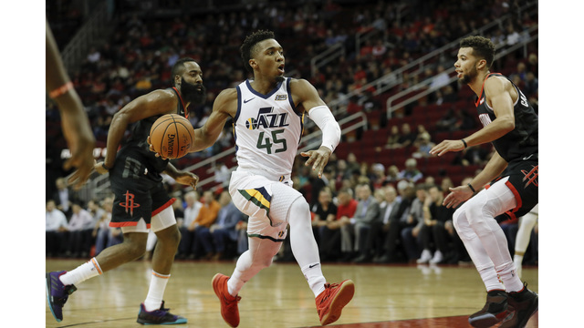 new styles 8b154 e1856 Donovan Mitchell gives shoes to young fan