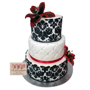 2383  3 Tier Wedding Cake with black stenciling and red ribbon   ABC     3 Tier wedding cake with black stenciling and red ribbon