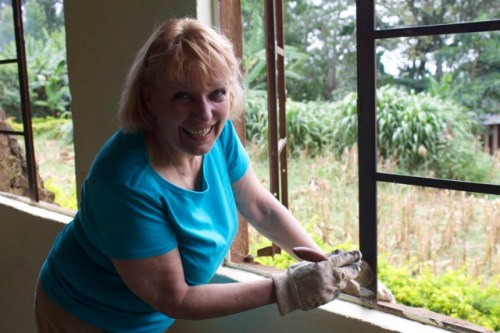 Susan painting window frames