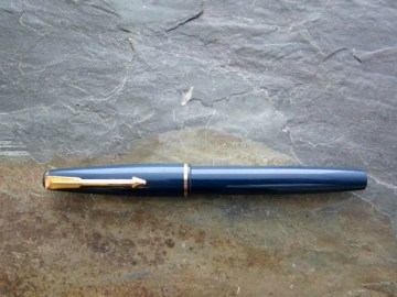 A Parker 17 Lady in blue with gold plated clip and cap bandfitted with a med 14ct gold nib. Price £16-00.