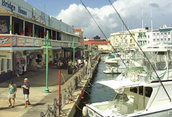 Tourists enjoy the ambiance and cuisine at the shallow draught Careenage, Bridgetown, Barbados.
