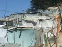 A tent city of bed sheets and wooden posts in Port-au-Prince, Haiti. Flavia Cherry photo