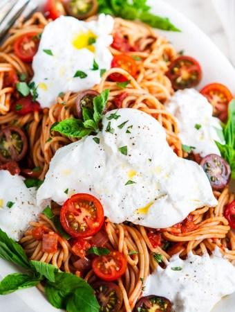 Tomato Basil Spaghetti with Burrata on a Serving Platter