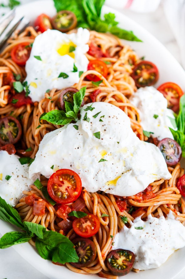 Tomato Basil Spaghetti with Burrata on a Serving Platter