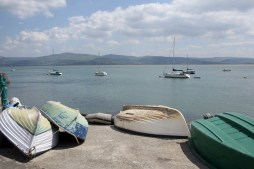 A selection of rowing boats near Aberdovey pier.