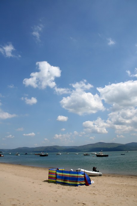 Sitting on Aberdovey beach with a wind break