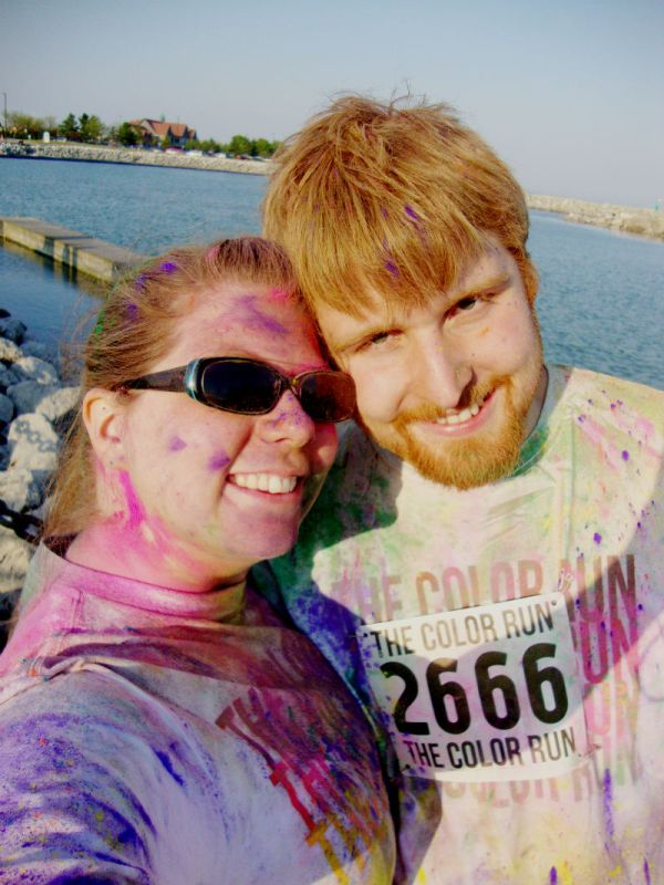 Couple covered in colorful powder after a 5k Color Run.