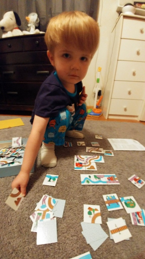 4 year old playing with board game