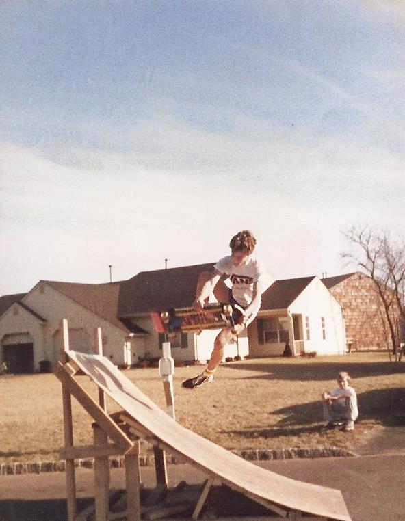 Todd bonelessing on a janky ramp back in the 80s.