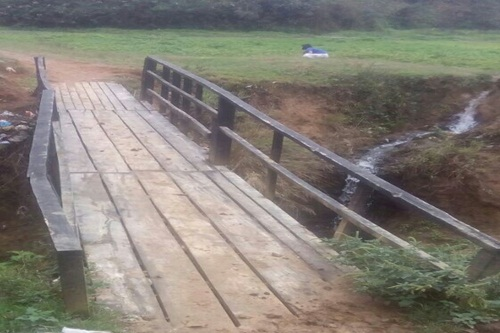 An old wooden Bridge on a stream