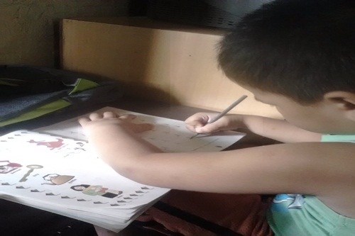 My Son doing his homework
