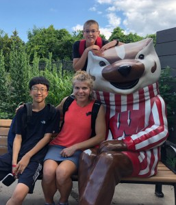 mom and two sons with Bucky Badger