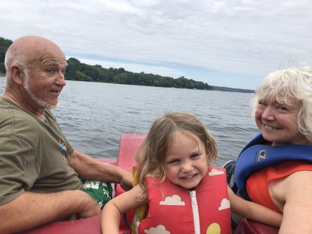Dad, Mom and grandchild in paddleboad