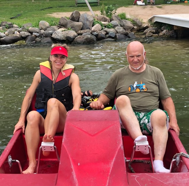 Dad and Adult Daughter pedaling paddleboat