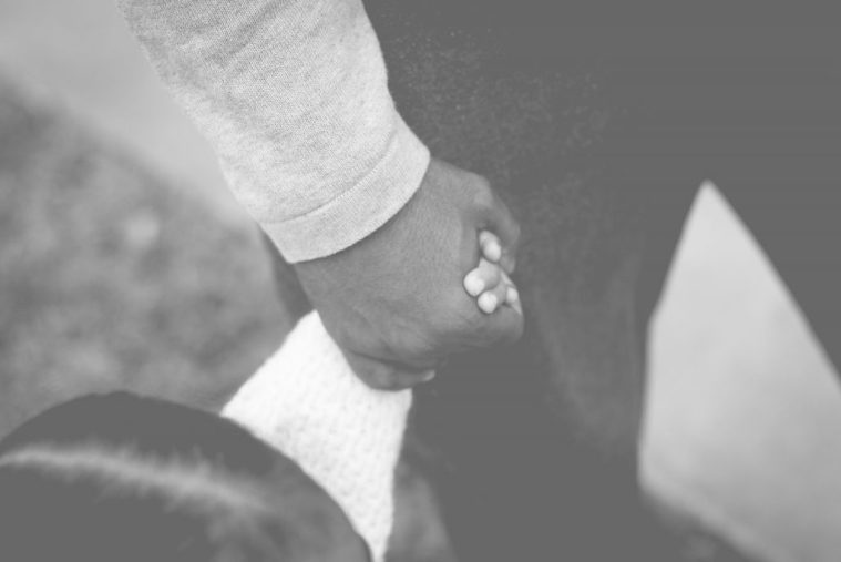 Father holding daughter's hand grace
