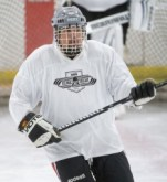 player holding hockey stick