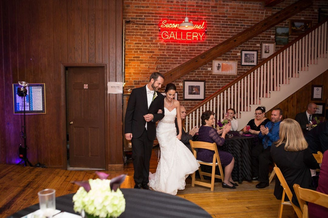 bride and groom announced at wedding reception at city art gallery