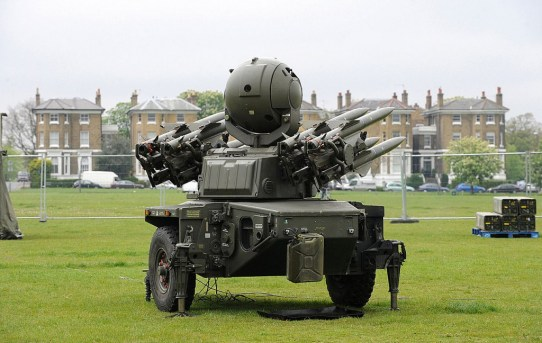 1280px-Soldiers_Load_a_Rapier_Missile_System_During_London_Olympics_Security_Exercise.jpg