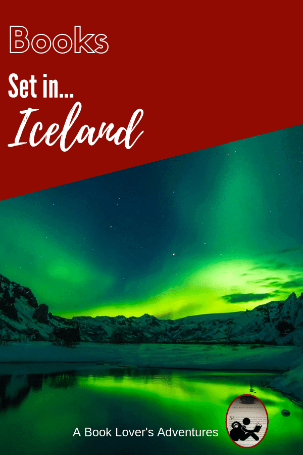 Image of Northern Lights over Iceland - greenish glow over mountains and water