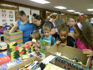 """Families choose two """"bonus"""" supplies per student during the Bath Back to School Drive Distribution Day, August 19, 2016 in Bath, NY."""