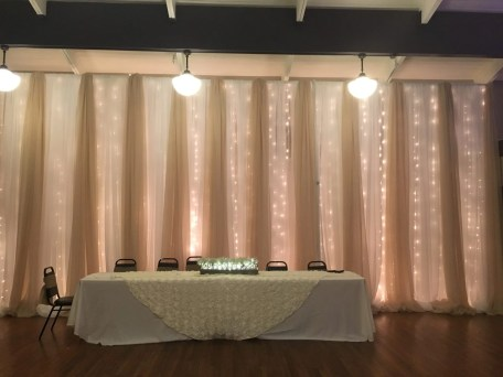 Set a magical tone with our waterfall wall that glows romantically. Design by Above the Rest Event Designs.
