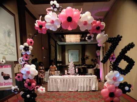 Sweet 16 flowered arch makes a perfect entrance