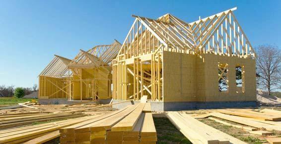 construction maison en bois avec pergola
