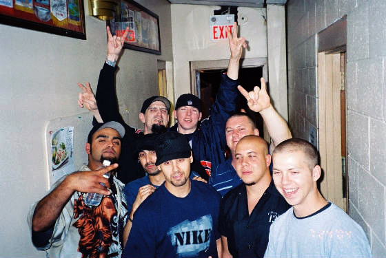 A Taste For Blood, circa August 5th 2004, after a show at Stag & Doe in Burlington. On far left: Bob Kareer (ex-band member), top left: Kevin Theo (owner of Stag & Doe), top right: Billy Foss (band member), middle: Fudd Bokhari (band member), bottom middle: unknown, right upper: Pauley Opperman, right center: Steve Camara (band member), right bottom: Zeb Foss (band member)