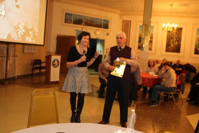 AMHS Pres Maria D'Andrea presents gift to Dr. Centini, Jan 31, 2016 meeting