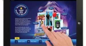 Guinness_World_Records_ipad_app_hand