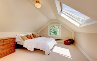 attic bedroom with skylight showing the benefits of skylights