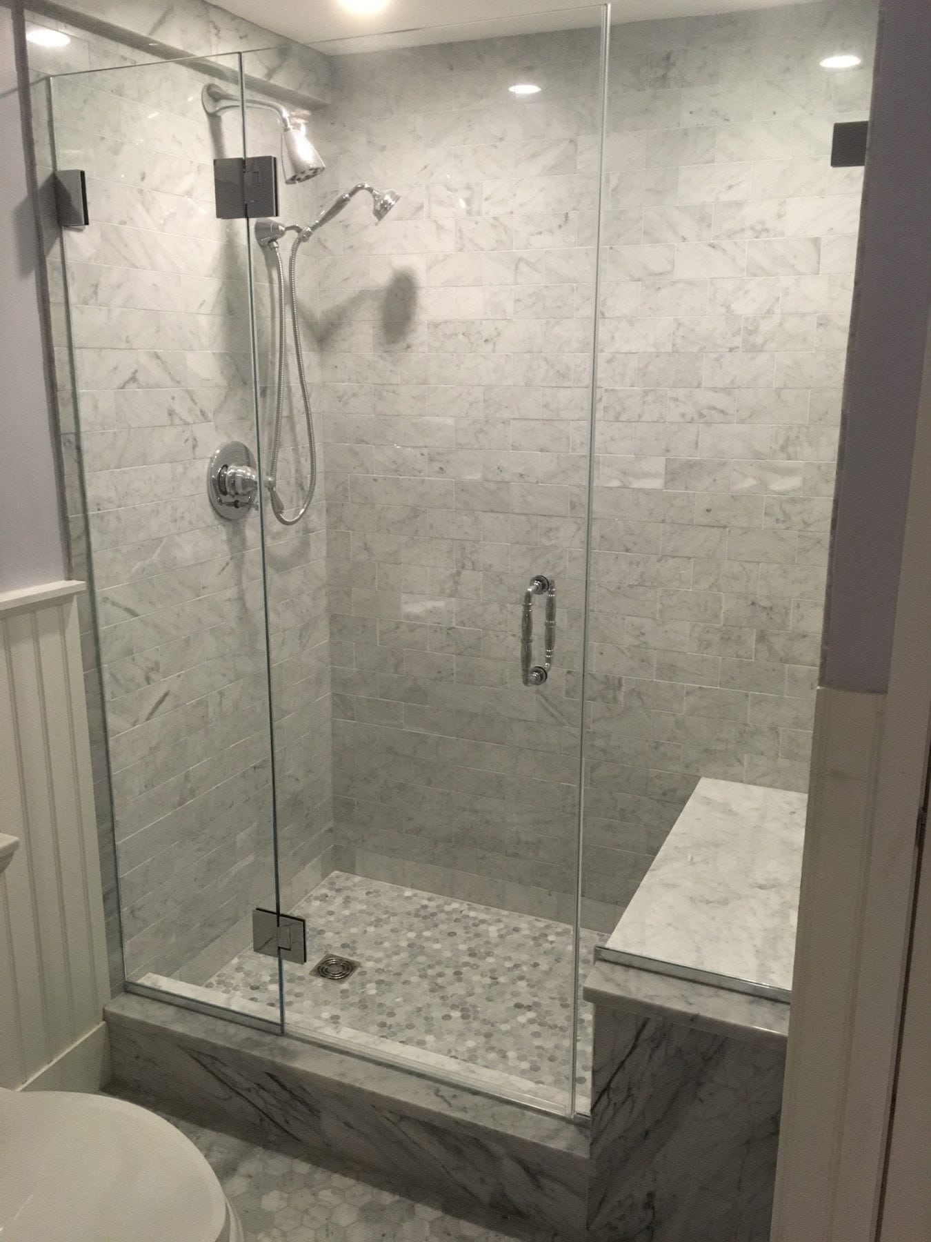 Frameless Shower Enclosure Door Hinged To Panel And Side