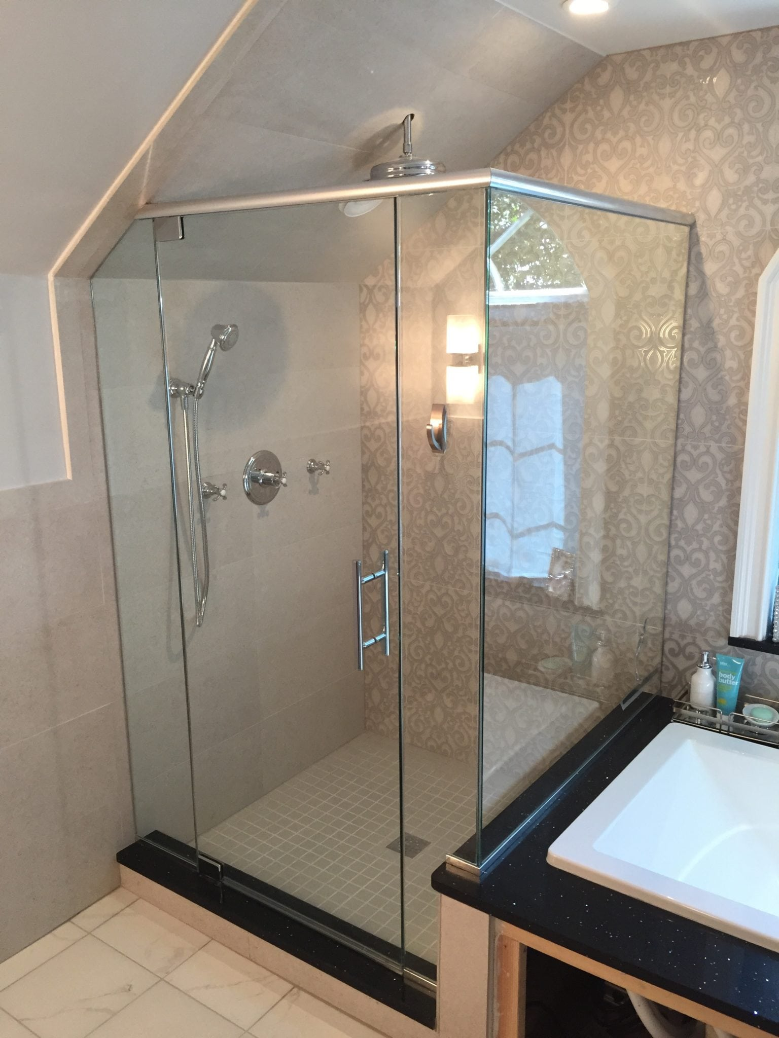 Frameless Corner Shower with Angled Ceiling
