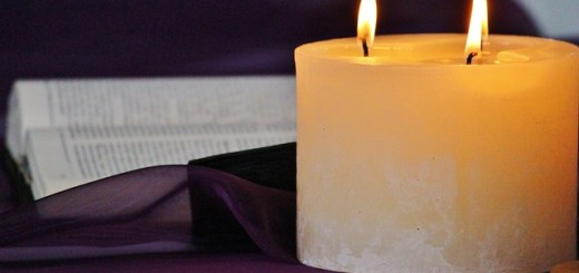 bible open with three wick candle