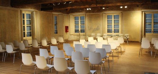 empty conference room with white chairs