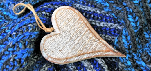 blue shawl with a wooden heart placed on the top