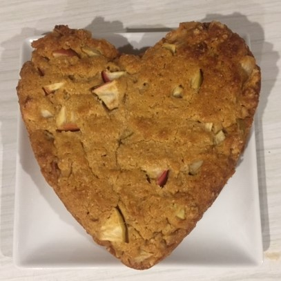 a heart shaped apple tea cake on a square white plate