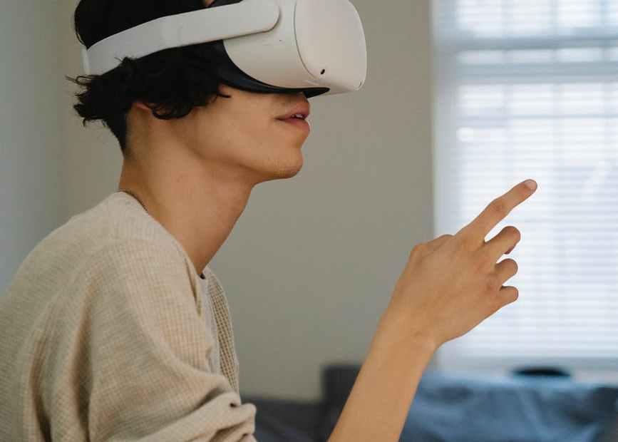 man exploring virtual reality in goggles at home