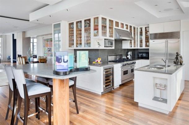wood-floors-in-white-kitchen-of-new-flooring.jpg