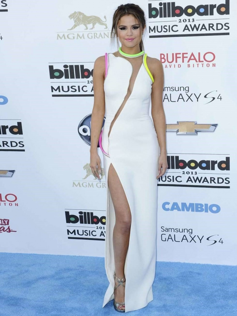 Selena Gomez attends the Billboard Music Awards wearing Atelier Versace dress with a thigh high slit, March 2013