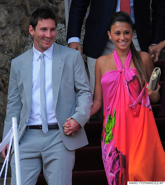 FC Barcelona's Lionel Messi, from Argentina, left, and his girlfriend Antonella Roccuzzo arrive to the Andres Iniesta's wedding at the castle of Tamarit in Tarragona, Spain, Sunday, July 8, 2012. (AP Photo/Manu Fernandez)