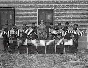 Albuquerque Indian School very early class of young boys with flags