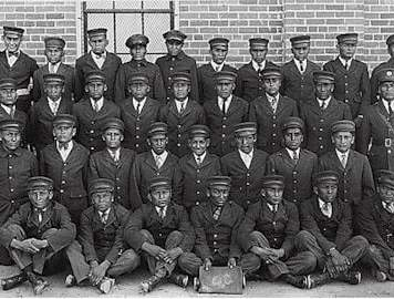 Older Albuquerque Indian School male students in uniform