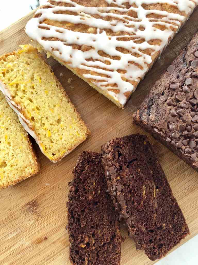 Chocolate and Lemon Zucchini Bread on a cutting board with two slices cut from each